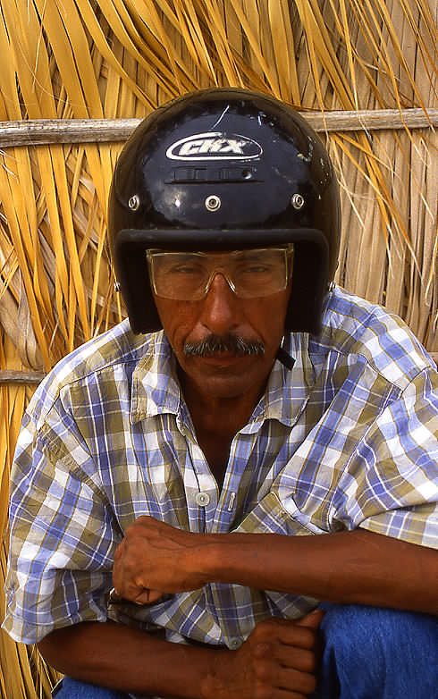 His name is Armando, he's 59 yrs old, a fisherman, and confident he can walk the 1100 kms to his hometown, but would really rather not.